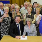 Some of committee and friends at the official lease signing